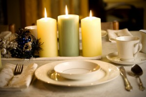 Simple and elegant dinner table setting by candle light