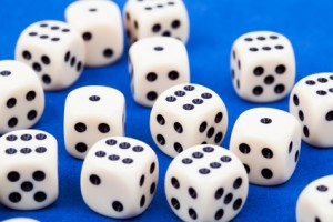 Dice rolling on blue background